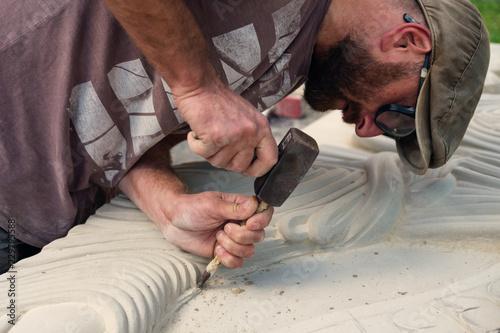 Fototapeta A sculptor is working