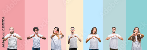 Fotografie, Obraz Collage of different ethnics young people wearing white t-shirt over colorful isolated background smiling in love showing heart symbol and shape with hands