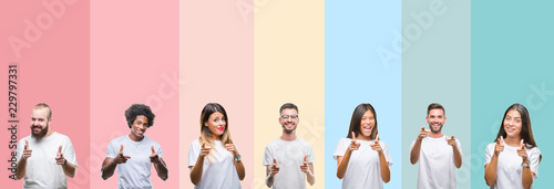 Fotografie, Obraz  Collage of different ethnics young people wearing white t-shirt over colorful isolated background pointing fingers to camera with happy and funny face
