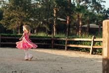 Girl Twirling In A Dress