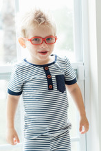 Boy With Orange Eyeglasses