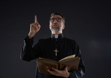 Priest Holding Bible Pointing ...