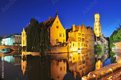 Wall Murals Bridges View of canal belfry and houses at Bruges Belgium.