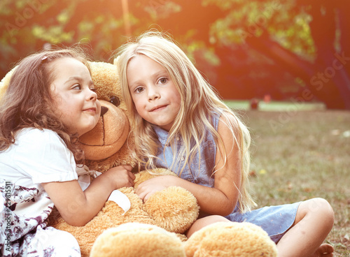 Acrylic Prints Artist KB Two cute girls hugging a huge teddy bear