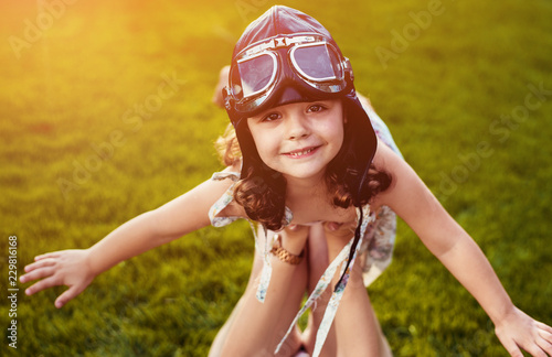 Acrylic Prints Artist KB Portrait of a little pilot girl having fun