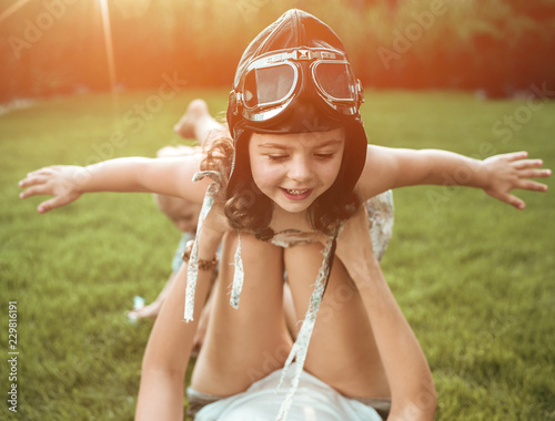 Acrylic Prints Artist KB Little pilot - girl having fun with a young mom