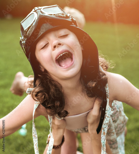 Acrylic Prints Artist KB Portrait of a little flying pilot-girl having fun