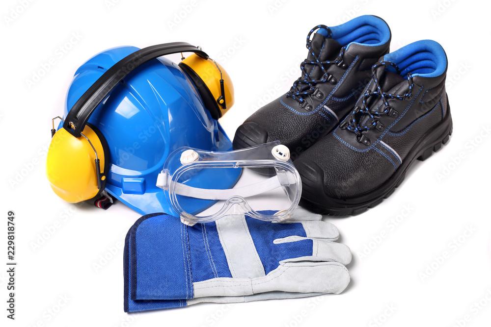 Fototapeta Zestaw dla pracownika zawierający niebieski hełm ochronny buty ochronne rękawice robocze i gogle przeciwodpryskowe