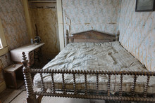 Old Bedroom In Historic Vintage American Home Gathering Dust After The Gold Rush