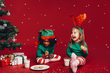 Kids Having Fun Eating Christmas Cookies