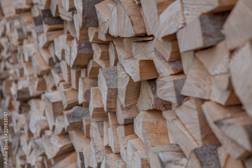 Material for heating the house. Preparation of firewood for the winter. background of firewood. A pile of firewood