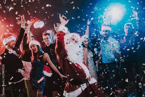 Obraz Man in Santa Claus Costume on New Year Party. - fototapety do salonu