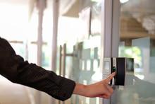 A Man Paste Finger To Biometric Fingerprint Scanner.