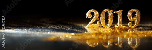Photo  2019 in sparkling gold numbers celebrating the New Year