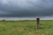Trail Marker Sign Along Trail Cutting Across Prairie
