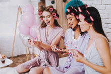 Three Girls Choose Pink Nail P...