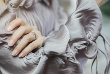 Close Up Of An Elegant Diamond Ring On Woman Finger. Soft And Selective Focus. Love And Wedding Concept.