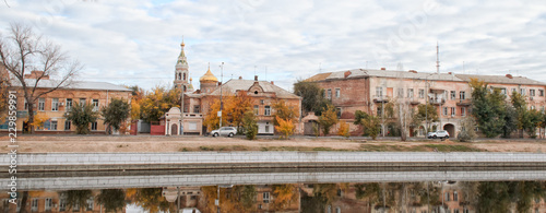 View of the city embankment, old houses and church of the ancient city of Russia Canvas Print
