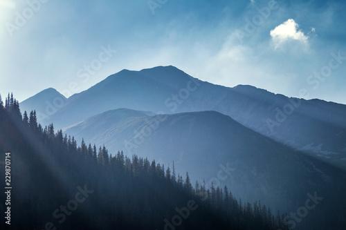 Montage in der Fensternische Blau Jeans Mountain landscape, the area of Rohace in Tatras National Park, Slovakia, Europe.