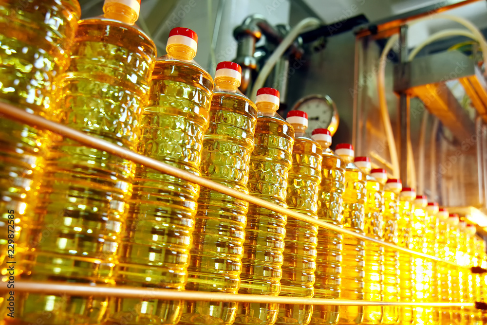 Fototapety, obrazy: Sunflower oil. Line for the production and bottling of refined oil from sunflower seeds. Conveyor of food industry