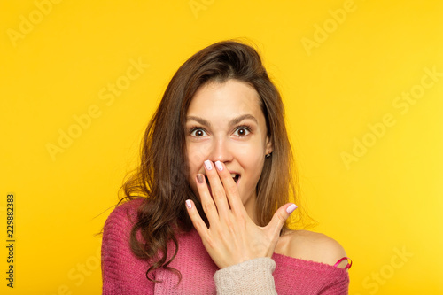Fotografie, Obraz surprised shocked astonished amazed girl covering mouth with hand