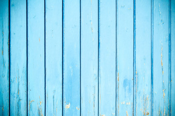weathered blue painted garage door background with vignetting