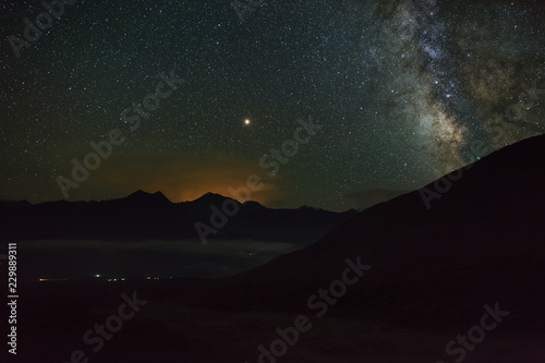 Keuken foto achterwand Bordeaux The bright stars of the Milky Way in the night sky over the mountains of the North Caucasus.