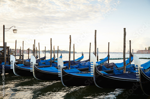 Spoed Foto op Canvas Gondolas Gondola boats moored in Grand Canal in Venice, nobody in the early morning