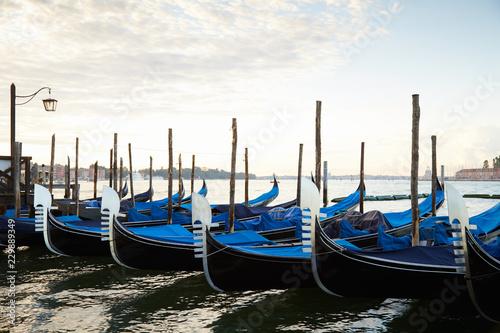 Foto op Plexiglas Venetie Gondola boats moored in Grand Canal in Venice, nobody in the early morning