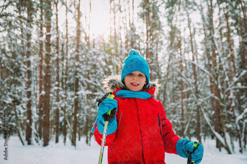 young boy ski in winter nature, seasonal sport