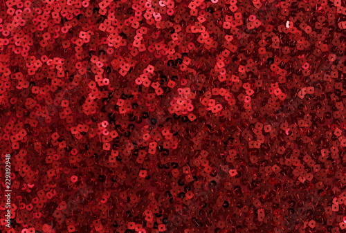 Fotografía  red sequin texture background. Christmas, festive background