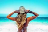 Fototapeta Fototapety z morzem do Twojej sypialni - Blonde woman girl on a blue sea ocean paradise view