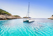 canvas print picture - Beautiful bay with sailing boat catamaran, Corsica island, France