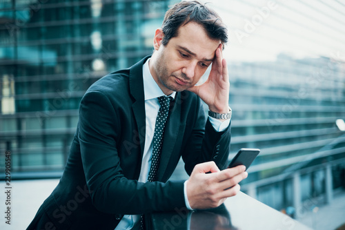 Fotografía  Sad thoughtful businessman portrait because of big problem