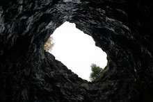 View Of The Sky And Trees From The Bottom Of A Stone Mine