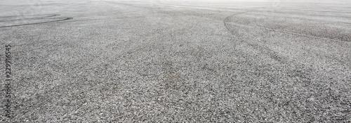 Car track asphalt pavement background at the circuit