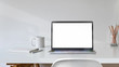 canvas print picture - Blank white screen laptop with office supplies on white desk workspace.