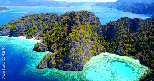 High Aerial View of Coron Lagoons - Crystal Clear Turquoise Bays With Visible Coral Reefs - Palawan, Philippines