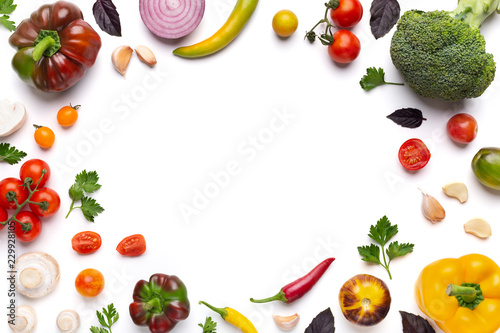 Valokuvatapetti Organic assorted vegetables frame on white background