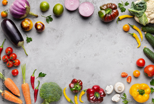 Fresh farm market vegetables on gray background