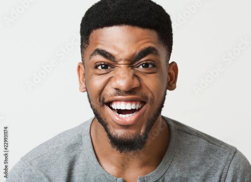 Fotografie, Obraz  Happy african-american man grimacing at camera closeup