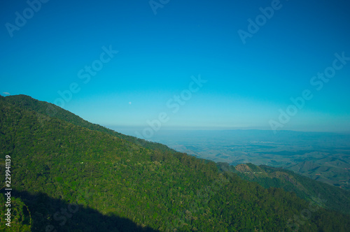 Spoed Foto op Canvas Blauwe jeans Moon rising at Mantiqueira landscape aerial view.