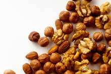 Overhead Image Of Assorted Nuts On White Background With Copy Space