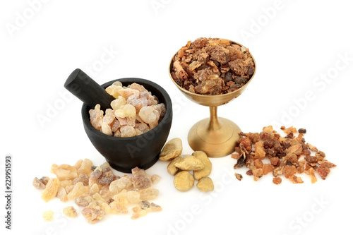 Fotografie, Obraz Gold Frankincense and myrrh in a mortar with pestle, old metal bowl and loose on white background