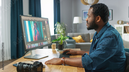 Professional Photographer Works in Photo Editing App / Software on His Personal Computer. Photo Editor Retouching Photos of Beautiful Girl. Mock-up Software Design.