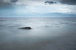 Misty seascape in Wales with Snowdonia in the background
