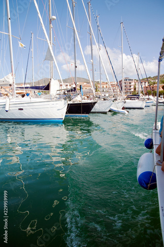 Foto op Canvas Poort Stretch of the harbor with a boat arriving, Marina di Camerota, Italy