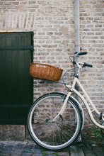Retro Bicycle Leaning On A Grungy Wall