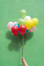 Bunch Of Balloons On Green Bac...