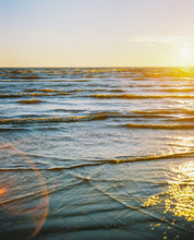 Waves In Sunset